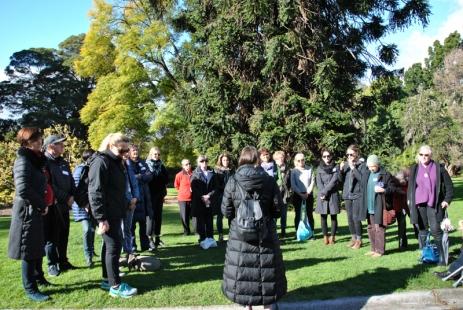 Poet Autumn Royal reading her poem in the Royal Botanic Gardens Victoria