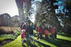 Poet Ryan Prehn reading his poem in the Royal Botanic Gardens Victoria
