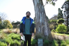 Poet Ryan Prehn with his poem 'Remnant' in the Royal Botanic Gardens Victoria
