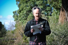 Poet Duncan Hose reading his poetry in the Royal Botanic Gardens Victoria