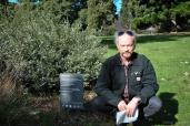 Poet Duncan Hose with his poem 'Golden Bogey' in the Royal Botanic Gardens Victoria