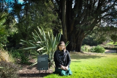 Poet Carissa Lee Godwin with her poem 'Arms of a Friend' in the Royal Botanic Gardens Victoria